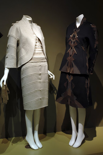 Suspensions began as small inserts sparingly set into standard-cut suits, but more than merely decorative or even technical exercises, they are functional and serve an essential purpose: they improve the fit.  As a result, garments constructed entirely of suspensions are rarely symmetrical and most often are reserved for the haute couture.