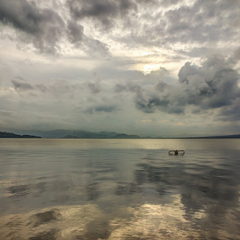 a loner by Oppie raQILLIE - Landscapes Cloud Formations