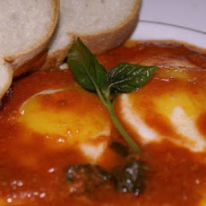 Eggs with a tomatoe and Bazil sauce.