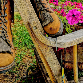 Junque For Sale by Barbara Brock - Artistic Objects Still Life ( old boots, boots and flowers still life, antique shop, petunias )