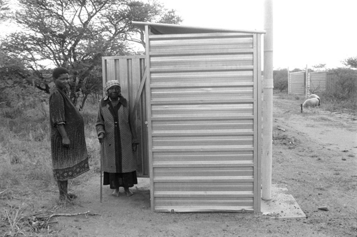 Toilets and thorn bushes. People who were forcibly removed by the apartheid government, were sometimes given tents. Toilets, however, were always available. The sight of rows of toilets in desolate areas would indicate immanent forced removals.