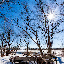 Hope for spring by Éric Senterre - City,  Street & Park  Historic Districts ( car, sky, blue, sleigh, snow, sun, rays )