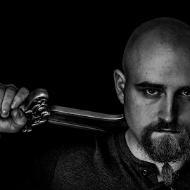 Stoic Warrior by Matthew Parks - People Portraits of Men ( warrior, black background, portraiture, blackandwhite, low key, black and white, low light, high contrast, portraits, portrait, man, sword )