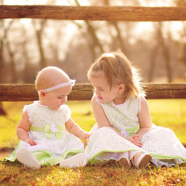 Two sisters to grow old together by Chynne Graham - Babies & Children Child Portraits ( fence, little girls, sisters, nature, green, children, kids, landscape, spring, chynne sue photography )