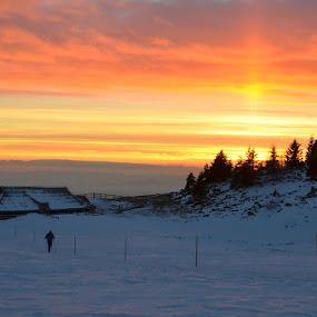 Walking in sunset at Velika planina by Silva Predalič - Landscapes Mountains & Hills ( velika planina, winter, sunset, snow, man, , cold )