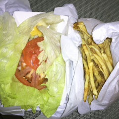 Burger wrapped in lettuce and fries