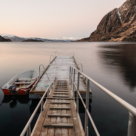 At the dock by Tzvika Stein - Landscapes Waterscapes ( reflection, mountains, red, boat, river, norway )
