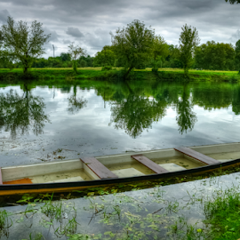Long wooden boat by Oliver Švob - Transportation Boats ( canon, water, reflection, tree, riverside, fisherman boat, baot, croatia, wooden boat, river,  )