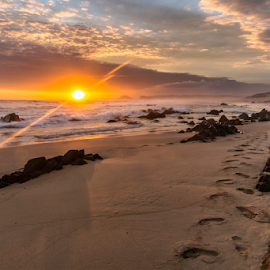 Footprints in the Sand by Clive Wright - Landscapes Sunsets & Sunrises ( sand, sea, rock, ocean, beach, sun )