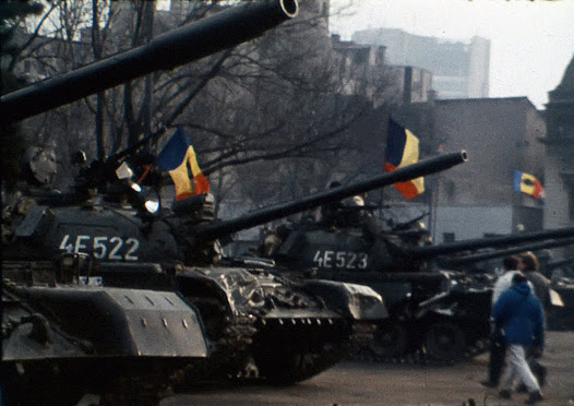After fraternizing with the people, the army tanks were decorated with flags with the coat of arms of the Socialist Republic of Romania cut out