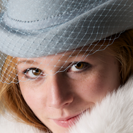 Close-up of smiling redhead in blue hat by Nick Dale - People Fashion ( girl, blue, woman, fur, redhead, veil, close-up, portrait, smiling, hat )