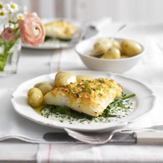Cheddar-crusted smoked haddock with Jersey Royals and creme fraiche sauce