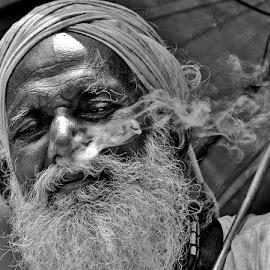 A Smoker ...... A Philosopher by Amit Naskar - People Portraits of Men ( philosopher, smoking, old man smoking, black and white portrait, smoke )