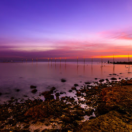 Sunrise by Bakir Ali - Landscapes Beaches ( clouds, water, pole, sunrise, stones, rocks, sun )