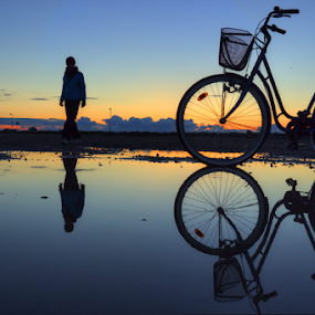 Everything is relative by Julija Moroza Broberg - Transportation Bicycles ( puzzle, water, playground, reflection, person, test, transportation, relative, bicycle, bike, blue, sunset, puddle, view, alone,  )