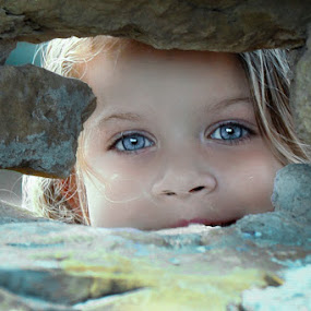 Peeking Through by Judy Rosanno - Babies & Children Child Portraits ( girl, peeking, blue eyes, wall, eyes,  )