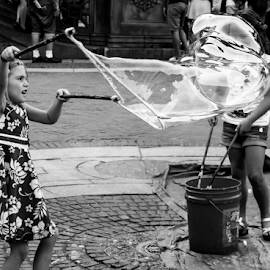 Bubbles in Central Park by Gina Gomez - Babies & Children Children Candids ( urban picture, bubbles in central park, urban photo, photos of new york city street, city streets, new york city streets, street, manhattan, big bubbles in central park, street scene, nyc, city people, nyc street, city landscape, urban jungle, urban, urban scene, big apple, big bubbles, blowing bubbles, new york city, new york street )