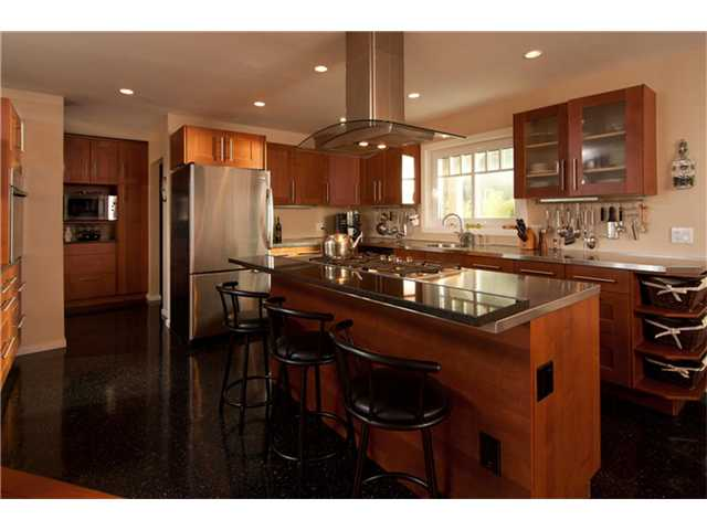 Commercial Kitchen with Granite and Stainless steel Countertops, Highend appliances featuring Island with Meile Cooktop. New Butler's Pantry Wing.