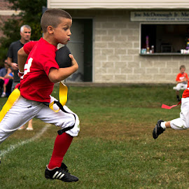 He's going the distance by Amy Vaughn - Babies & Children Children Candids ( flag football, intensity, sports, children, kids, running, youth sports,  )