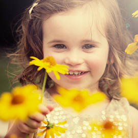 Hiding behind the flowers by Joseph Humphries - Babies & Children Child Portraits ( child, browneyes, inccocent, lilies, daisies, children, flowers, smile )