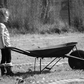 Hard at work by Wimpie Theron - Babies & Children Children Candids ( child, wheel, black and white, childhood, working )