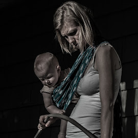 mom and baby by Brent Carden - People Maternity ( tone, water hose, jeans, baby, mom )