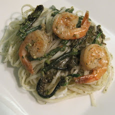 Sauteed Pohole (Fern shoots) and Shrimp with Lemon Balm Pesto on Rice Noodles