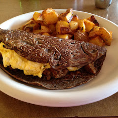Buckwheat Breakfast Crepe with eggs, ham and fries.
