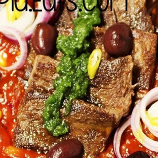 Ox Tongue Recipe With Tomato Sauce And Black Olives.