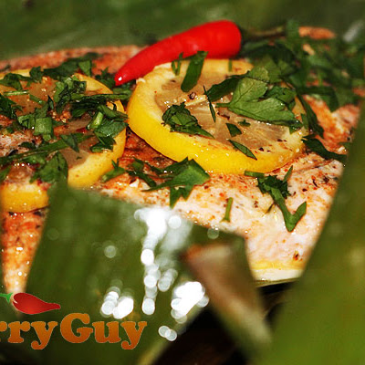 Spicy Salmon Fillet Baked In Banana Leaf