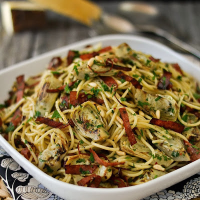 Spaghetti with Garlic and Oil (Aglio e Olio) with Artichokes, Crisped Salami and Pine Nuts
