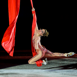 Acrobatic Ice Skating by Luca Renoldi - Sports & Fitness Other Sports ( red, girl, ice skating, show, light, acrobatic )