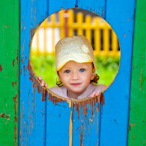 Caught in action - smiling by Viktoryia Vinnikava - Babies & Children Toddlers ( may, sincere, 2014, green, belarus, yellow, spring, pretty, grodno, eyes, kid, child, girl, blue, blue eyes, smile,  )