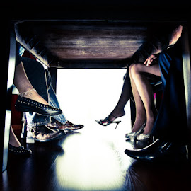 Under the Table by Aller Beauchamp - People Body Parts ( dinner, lifestyle, dating, couples )