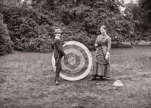 Robert and Georgiana Dillon playing archery, Clonbrock, Ahascragh, Co. Galway, ca. 1883.  (CLON 434).