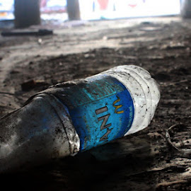 Abandoned by Rendan Lovell - Food & Drink Alcohol & Drinks ( water, old, blue, dasani, dirt )