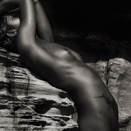 the Arch by Thomas Moke - Nudes & Boudoir Artistic Nude ( canon, natural light, nude, black and white, sensuality, skin, natural beauty, erotic, sexy, sunset, woman, naked, magic hour, laying, hair, rocks, nudes, golden hour )