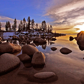 Sand Harbor Twilight by Geoff McGilvray - Landscapes Sunsets & Sunrises ( calm, water, boulders, peaceful, seasonal, twilight, reflections, lake, landscape, high sierras, sunburst, winter, nature, sunset, serene, sand harbor, lake tahoe, granite )