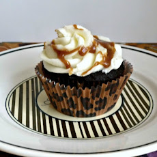 Dark Chocolate Cupcakes with Salted Caramel Filling and Vanilla Butter Cream Frosting and Caramel Drizzle.