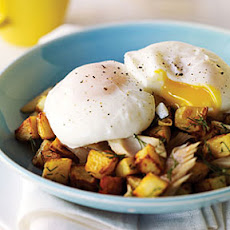 Poached Eggs With Smoked Trout and Potato Hash