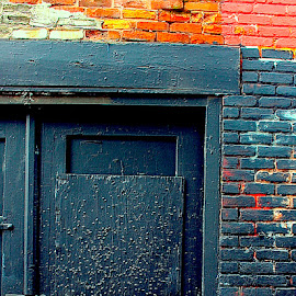 Bric a Brac by Ronnie Caplan - Buildings & Architecture Architectural Detail ( painted, coloured, wood, door, delapidated, streetscene, frame, facade, graffiti, bricks, decayed, wall, peeling, abandoned )