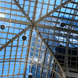 Skylight, Eaton Centre Montreal by Ronnie Caplan - Buildings & Architecture Architectural Detail ( vertical, sky, patterns, arch, horizontal, buildings, cloud, windows, lines, skylight, stripes, shadows )