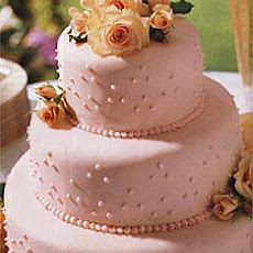 Fondant-Covered Wedding Cake with Raspberries and Chocolate
