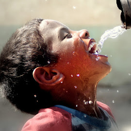 a water drop = a life  by Ahmed Waheed - Babies & Children Children Candids ( water, sinai, desert, happy, drops, egypt, kid )