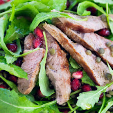 Griddled Lamb Steaks With Green Lentils, Pomegranate And Rocket