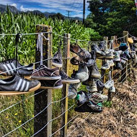 shoe fence by Vibeke Friis - Artistic Objects Clothing & Accessories ( hanging, shoe fence, lots of shoes, sneakers,  )