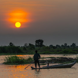 Sunrise on the Tonle Sap by Matthew Haines - Transportation Boats (  )