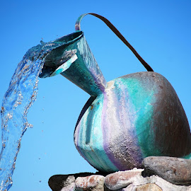 Pitcher with running water by Lia Richardson - Artistic Objects Still Life ( water, sky, pitcher, artistic, object, rocks,  )