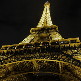 Tower At Night by Megan Richardson - Buildings & Architecture Public & Historical ( lights, eiffel tower, paris, landmark, france, night, historical, travel )