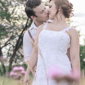 Pink by Lodewyk W Goosen-Photography - Wedding Bride & Groom ( love, kiss, wedding, couple, marriage, passion, fields )